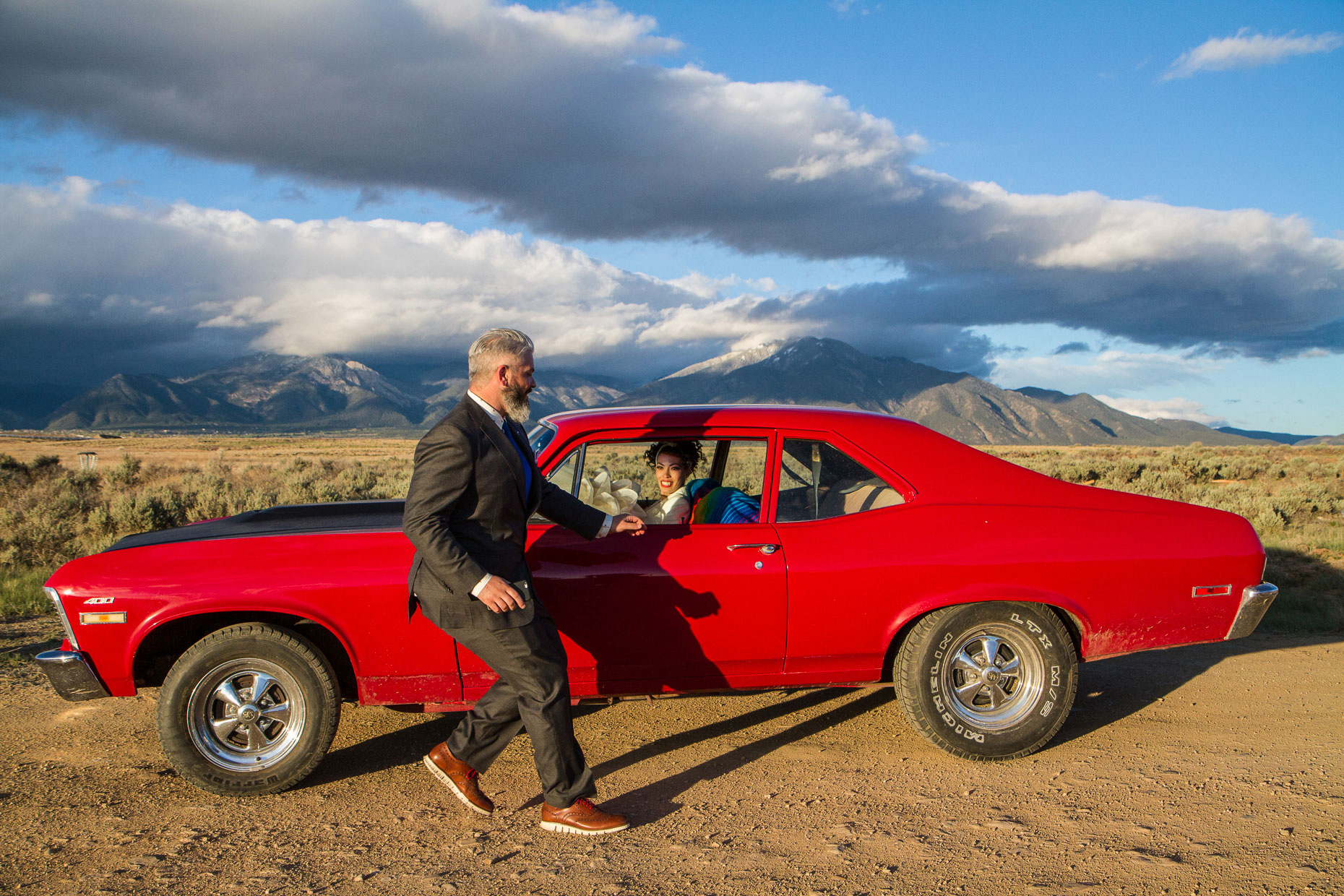 Taos Mesa Brewery wedding couple in red car