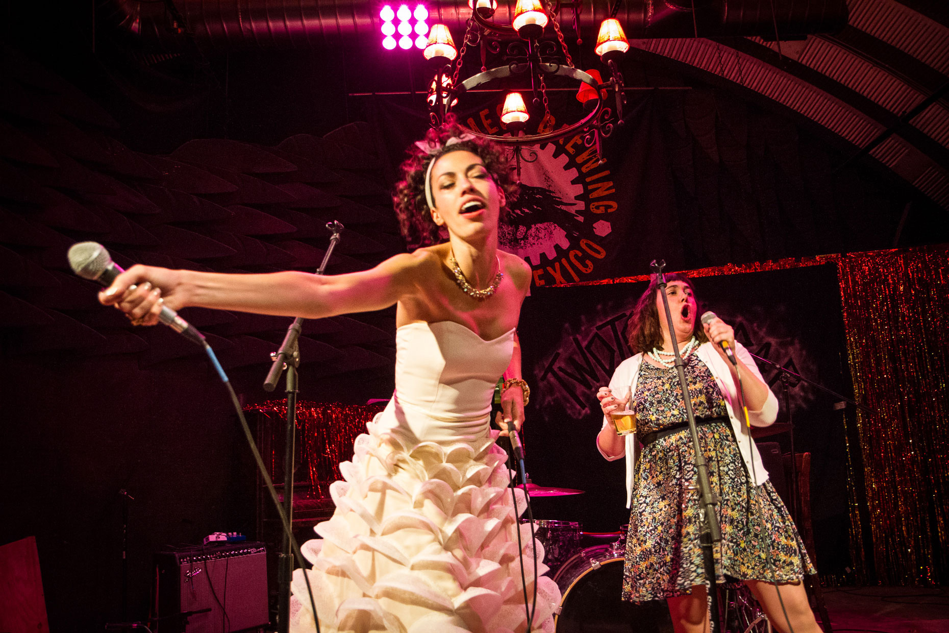 Taos Mesa Brewery wedding reception, bride sings heavy metal on stage