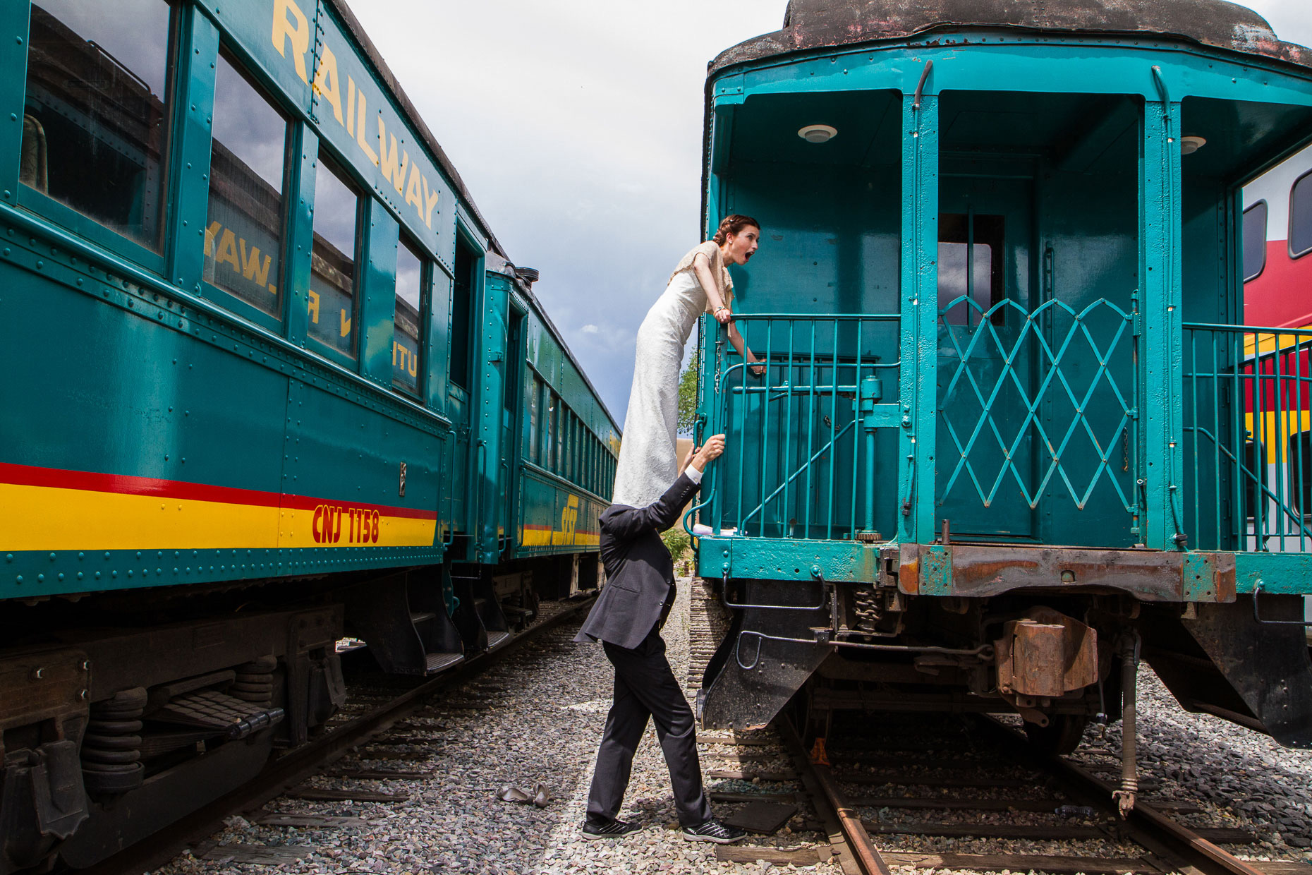 Santa Fe Railyard funny couple on train, Elopement photography