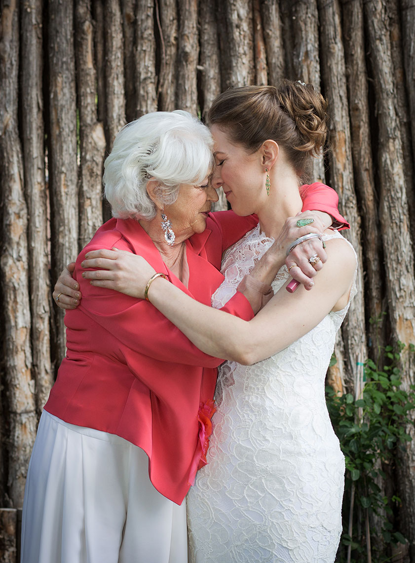 Bride hugging mother at a Santa Fe Canyon Road Wedding