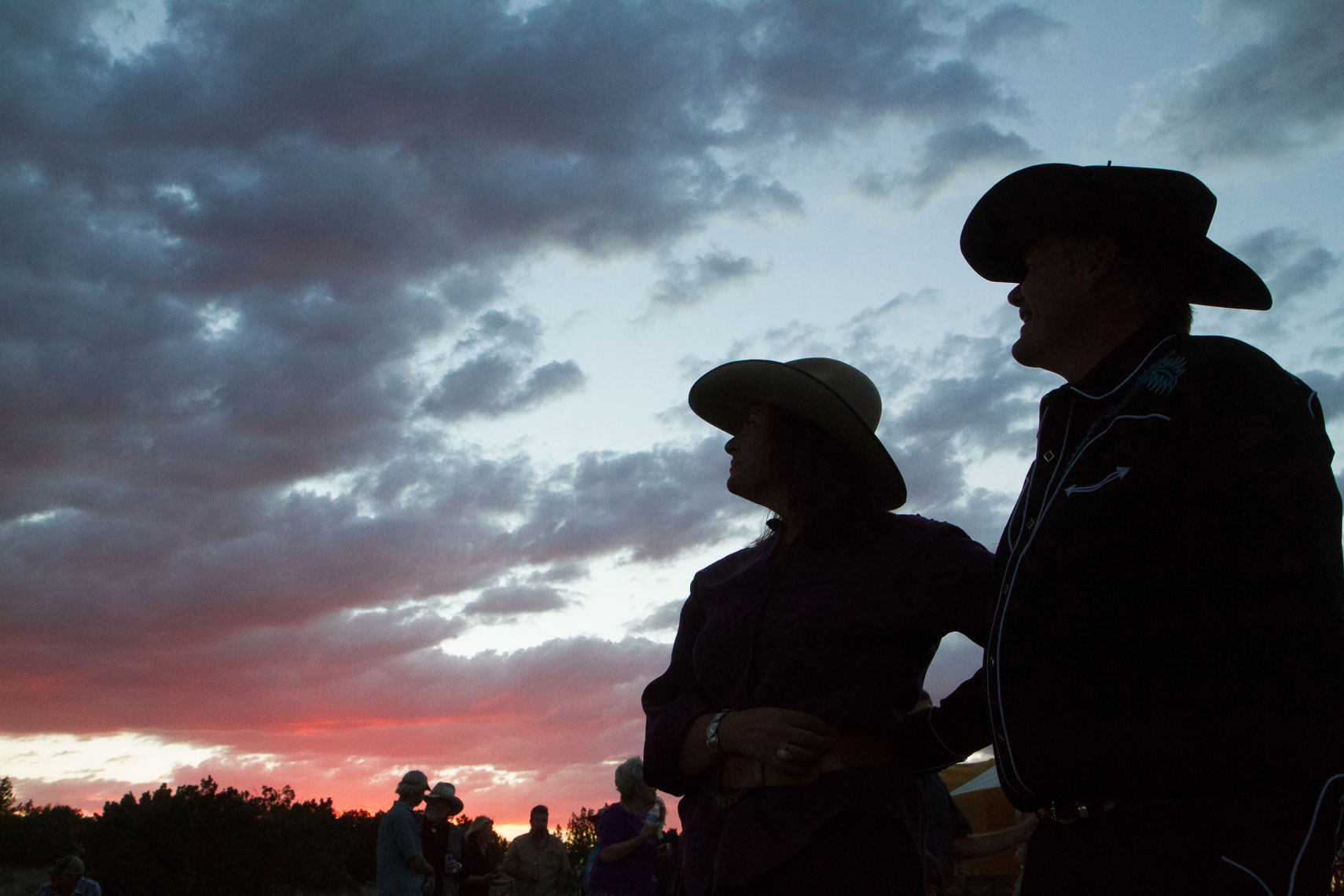 Cowboy hats and wedding couple, sunset on the ranch