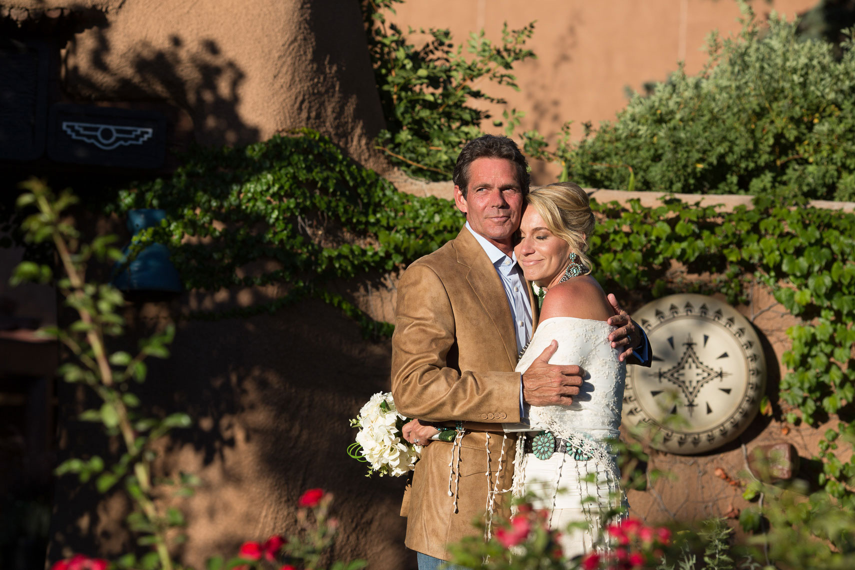 Wedding Couple at Inn of Loretto, Santa Fe with sunset light