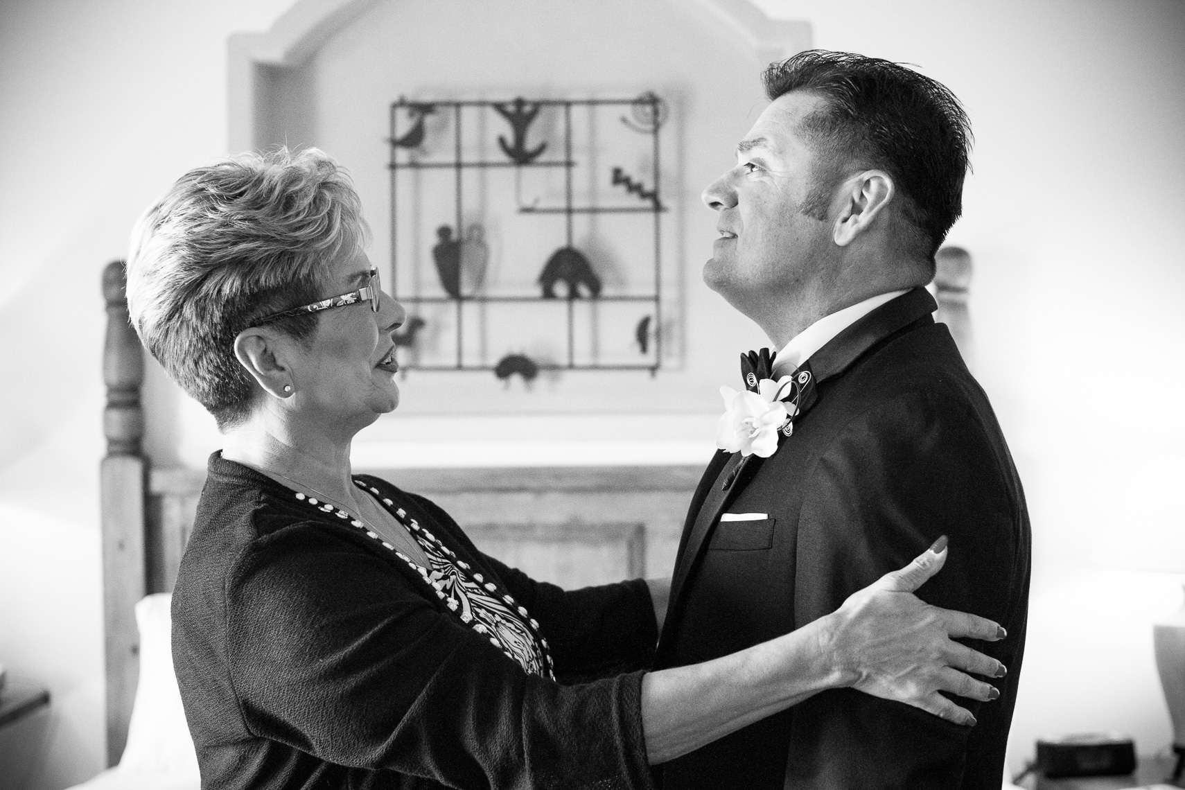 Gay wedding at Bishops Lodge, One of the grooms has a moment with mother