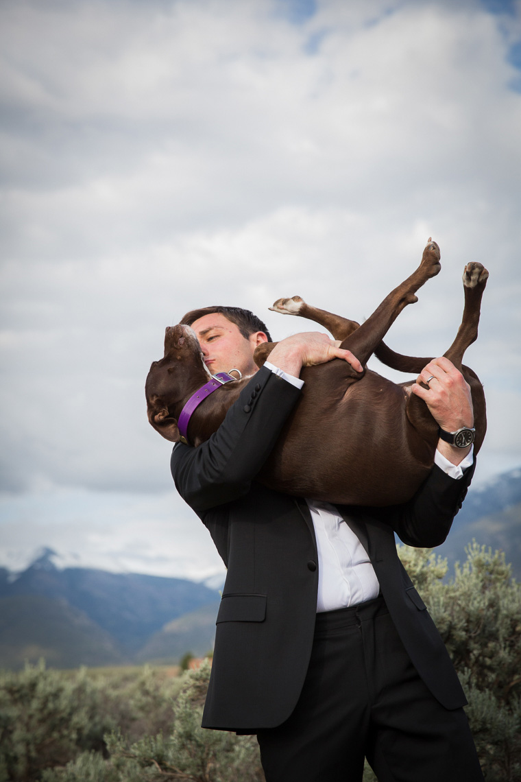 Taos groom kissing dog
